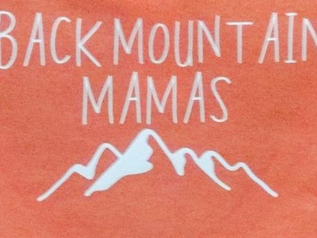 "A sign in red and white that reads, ""Black Mountain Mamas"""