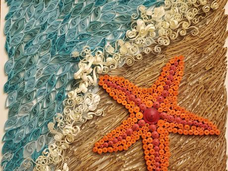 Paper craft of a starfish on a beach