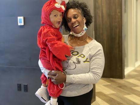 Woman and child with an Elmo costume on.